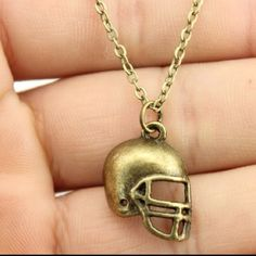 Football necklace Very nice bronze American football necklace chain is 19 inches and adjustable if wanted it shorter brand new in package Jewelry Necklaces
