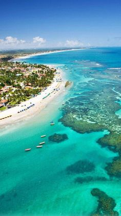 Make a beach day out of your trip to Porto de Galinhas. This Brazilian beach is famous for its bright water and natural pools.