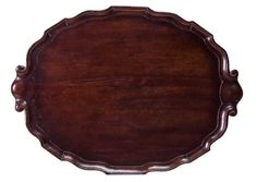 Willis Henry Auctions. March 29, 2014. Lot 201: 18th c. Tea Tray.   Estimate: $300 – $500.  SOLD: $708 (includes Buyer's Premium).    Fine carved Chippendale tea tray, mahogany, molded and scalloped edging with scrolled handles at either end, overall good condition with minor blemishes, 23″ l, 17″ d, (ex. the Judge Oliver House, Middleboro, Mass.).