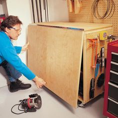 How to Build a Compact Folding Workbench with Storage Fit a huge work area into a small space with this folding workbench.