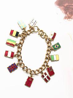 Vintage country flag souvenir bracelet   1940's enamel travel link bracelet   travel country charm link bracelet   gift for traveler by StaceyFayDesigns on Etsy https://www.etsy.com/listing/587224417/vintage-country-flag-souvenir-bracelet