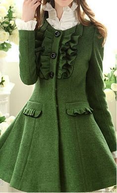 An amazing coat for a formal occasion! These classy wool blend coats are fully lined with a nylon lining and have a classy and vintage finish. Made with ruffle detailed front pockets, they come equipped with a ruffled flouncing center giving them a classy and vintage flare. The large buttons are snapon buttons making the coat easy to open or close. They have a round collar and are complete with vintage bubble sleeves. These are available in XS-L in limited quantities