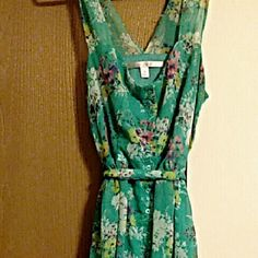 Colorful floral dress This is a beautiful green colored dress with yellow, pink and purple flowers. Button down dress completely. No longer fits but wonderful condition, also very comfortable! Updated pictures since the others were blurry Lauren Conrad Dresses