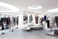 An overview of Marni's Hangzhou Tower store; featuring portable stainless steel rails, the iconic tree hanger and backlit display boxes.