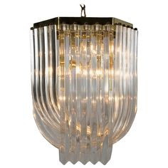 Lucite Ribbon Chandelier, 1970s   From a unique collection of antique and modern chandeliers and pendants at https://www.1stdibs.com/furniture/lighting/chandeliers-pendant-lights/
