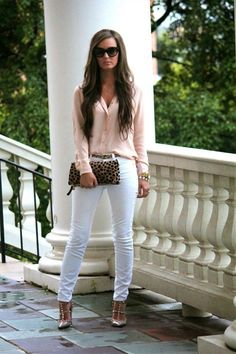 Pink blouse, white skinny jeans, metallic shoes.