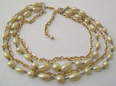 A lovely vintage four strand faux pearl beads and gold tone chains necklace The beads are wire linked Simple hook fastener Measurement approx 49 cm Pearl Beads, Pearl Necklace, Vintage Wedding Jewelry, Pearls, Chains, Gold, Wire, Jewellery, Simple