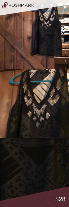 Guess tank top with sequins and sheer tribal print Guess LA sequin embellished top. XS EUC sheer black with a tribal type print below. Beautiful and flowy on.   From a smoke free home. Guess Tops Tank Tops