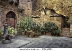Courtyard with Water Fountain in Medieval Village of Buonconvento, Italy