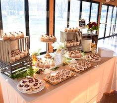 In addition to a cutting cake, Jessica and John also chose to have a cupcake and cookie table for their guests to enjoy! Cookie Table Wedding, Wedding Cookies, Wedding Desserts, Table Set Up, A Table, Cupcake Table Displays, Rustic Cupcake Display, Rustic Cupcake Stands, Deco Buffet