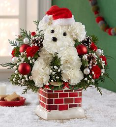 Santa paws is ready for Christmas! Hand-crafted with a festive mix of seasonal flowers and ornaments, our favorite holiday pup is tucked inside our exclusive, snow-topped chimney container and is ready to spread Christmas cheer to family & friends! Christmas Flowers, Christmas Balls, Christmas Holidays, Christmas Wreaths, Christmas Decorations, Holiday Decor, Christmas Gifts, Advent Wreaths, Xmas