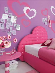 Purple girls bedroom with hearts on wall. So cute.