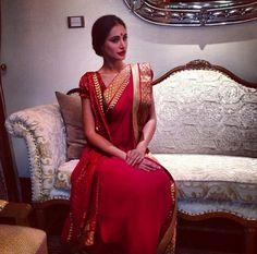 Nargis Fakhri in red saree worn Bengali style