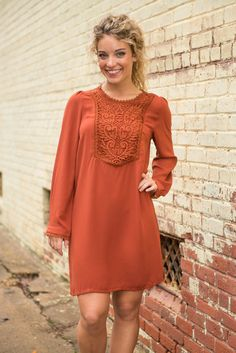 Grand is the perfect word to describe this dress! From the color to the style to the crochet, everything about this dress is grand!  Material has no amount of stretch. Judith is wearing the small. Sizes fit: Small- 2-4; Medium- 6-8; Large- 10