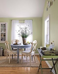This is the makeover dining nook. I liked the stained table from the previous version, but again the rug really adds to this setup.
