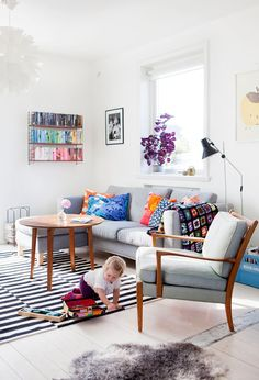 I like this living room, but I also want to learn how to crochet one of those quilts.