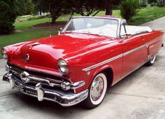 1954 Ford Red Crestline Convertible, with White Interior.