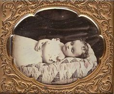 ca. 1850's, [post mortem daguerreotype portrait of a child on a patchwork quilt], Carleton via Be-Hold Fine Photographs