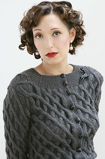 This gorgeous textured cardigan dates from the 1930s era.