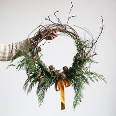 Evergreen-pinecone wreath. http://emersonmerrick.blogspot.com/2012/12/holiday-shop-and-wreath-class.html
