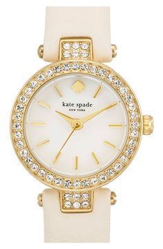Love how the shiny crystals illuminate the round face of this dainty Kate Spade leather-strap watch.