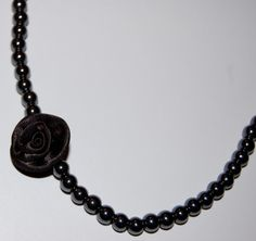 Black satin flower on gunmetal beaded necklace.