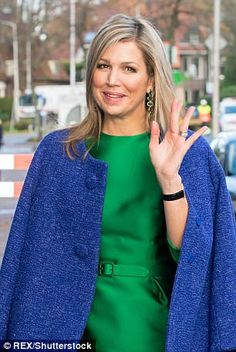 In light of the cold weather Maxima wrapped up in a chic bright blue wool coat as she arri...