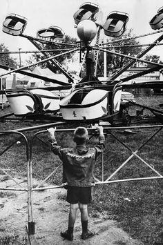 A boy wearing a fringed buckskin jacket looks at the Octopus ride at the county fair., is first in line at Berea fair octopus ride. Amusement Park Rides, Abandoned Amusement Parks, Eaton School, Richard And Adam, Fair Rides, Carnival Rides, Boys Wear, Coney Island, Lake View