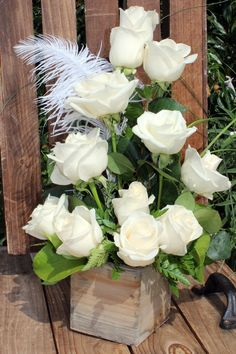 """Whatever the occasion White Roses are elegant and stunning. A dozen white roses arranged with mixed greens. Resting in a 4"""" by 4"""" wooden box. Simple and sophisticated white roses are a gift they will"""