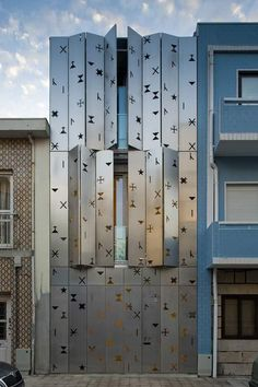 House 77 with perforated aluminum shutters in Póvoa de Varzim, Portugal. By dIONISO LAB
