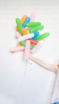 Fill long balloons and apply the string to different areas so they look like a cute bundle of sprinkles!