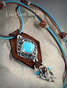 This is Sleeping Beauty Turquoise bezel set in fine silver metal clay with two charms dangling at the bottom that represent my two boys who have strong, Christian faith.  <3