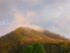 Fleaback Mtn, NC in Fall-2. This small mountain in western NC with an unusual name is enshrined here in beautiful Fall pastels and crowned with an evening sun-drenched cloud. Prints are available on Imagekind. www.applecorestudio.imagekind.com