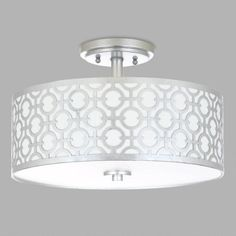 With a white fabric drum shade overlaid with carved metal finished in silver, our flush-mount ceiling lamp steals the show in any room. Inspired by the glamorous opulence of Old Hollywood, it's a timeless piece with a modern flair.