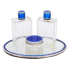 Art Deco Four Piece Blue And White Enamel Silver Dresser Set | From a unique collection of vintage enamel frames and objects at http://www.1stdibs.com/jewelry/objets-dart-vertu/enamel-frames-objects/