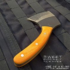 A custom, One Of A Kind version of the Bladetricks Sweet Pocket cleaver.