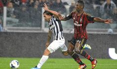 Juventus\' Tevez is challenged by AC Milan's Constant during their Italian Serie A match in Turin