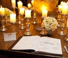 guestbook table with gold candles.