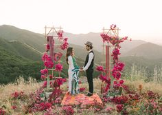 Gorgeous ceremony setup with bougainvillea branches and the hills of Malibu...