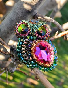 """Eyes catching handcrafted brooch/pendant transformer """"Owl"""" made with Swarovski crystals, Czech glass beads, and Japanese seed beads."""