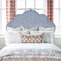 Inspired by the languid architecture of India, these exotic headboards are handmade by craftsmen in North Carolina. Choose your favorite of three rhythmic shapes, thirteen hand block printed fabrics from our fabric line, and the option of siderails.