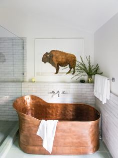 """Master Bath. The original master bath had a massive tub and enclosed shower stall. """"Putting in a freestanding tub and a glass shower did a lot,"""" says Merrill."""