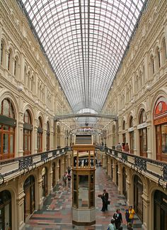 GUM department store in Moscow. It has a clear roof. GUM was built in 1890 –…