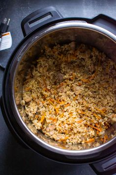My Instant Pot Chicken and Rice is simple Ukrainian pilaf (plov) recipe with onion, carrot, boneless chicken and brown rice. Each grain is separate, kids love it and it's so good you could entertain with it.