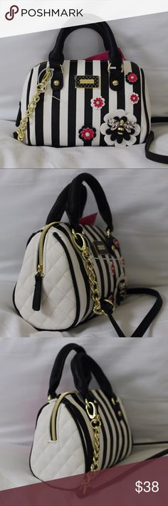 Betsey Johnson Mini Satchel Crossbody Black and white striped mini satchel with detachable crossbody strap. Bag has a single zippered compartment. Cute flower and bee decoration on the front. Lined with dark purple BJ fabric. Bag is new. Betsey Johnson Bags Satchels