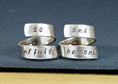 """This """"To Infinity & Beyond"""" friendship ring set is great for best friends or couples that want to show their bond. There is an infinity symbol stamped on the inside of each ring to symbolize that some people really are best friends forever. Each ring is hand stamped with care, one letter at a time."""