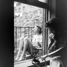 Photographic Print: Model Jean Patchet Seated on a Fire Escape, Talks with Eileen Ford, New York, NY, 1948 by Nina Leen : Robert Doisneau, Pont Des Arts Paris, Fire Escape, Ford Models, Life Magazine, Vintage Photography, White Photography, Model Agency, Great Photos