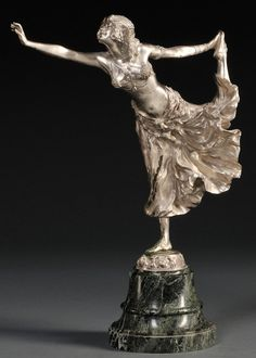 "After Claire Jeanne Roberte Colinet (French, 1880-1950), silver-colored, cast bronze figure of an Egyptian dancer, balanced on one foot and wearing an elaborate headdress, jewelry, and full skirt, on a base signed ""CJ.R.COLINET,"" raised on a marble pedestal, bronze ht. 13 1/4 in.   