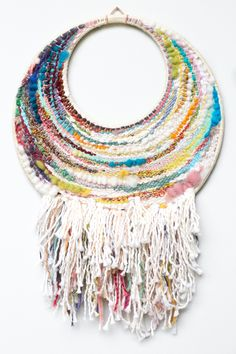 This is a one-of-a-kind, handwoven wall hanging. Most of the yarn used in this weaving is reclaimed or recycled. The wall hanging measures 10 x 15 inches, and it is ready to hang. Made in Portland, Oregon. 2015.