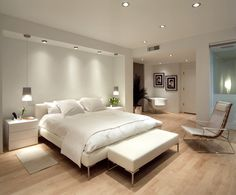 White & light wood modern bedroom. So serene.